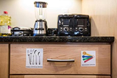 12/30/2014 SOMERVILLE, MA Labeled kitchen drawers at 3LPlace Life College Residence in Somerville. (Aram Boghosian for The Boston Globe)