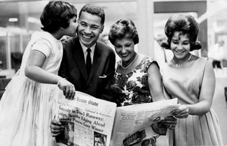 9/18/62 -- BOOK31B1 --Edwina Brooke, 10, kisses father Edward W. Brooke, Republican nominee for attorney general, and his wife, Remigia, and daughter, Remi, 13, check election returns in the Globe. NOTE: if you change this caption please add your innitials. Library Tag 12312006 Books /