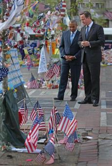 Governor Deval Patrick honored the Boston Marathon bombing victims with Britain's prime minister, David Cameron, in May 2013.