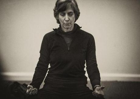 Arlington, MA 2/26/15 Lisa Fredman, Arlington, meditates. Photos of people meditation for a first-person Living Arts story by Kara Baskin on the benefits of meditation. This class is called Mindful Self Compassion, led by Brenda Rogers at the Arlington Center in Arlington, MA