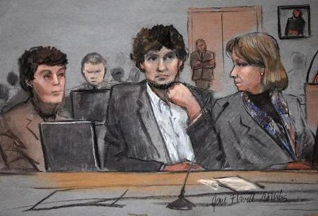 Dzhokhar Tsarnaev (center) is depicted in a courtroom sketch between defense attorneys Miriam Conrad (left) and Judy Clarke.