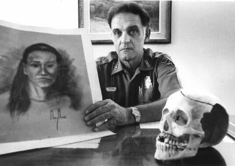 Provincetown Police Chief James Meads with the skull of the unidentified murder victim in 1987.