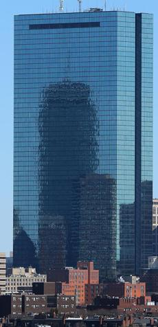 BOSTON, MA - 3/19/2015: REFLECTIONS on the John Hancock Tower of the Prudential Building seen from Roxbury. (David L Ryan/Globe Staff Photo) SECTION: METRO TOPIC stand aone photo