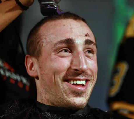 Marchand smiled during his haircut.