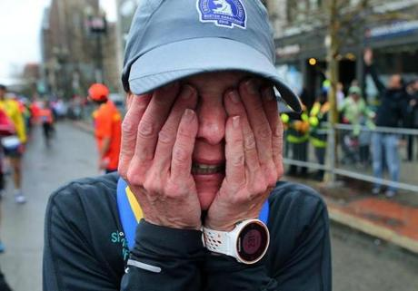 Boston-04/20/15- The Boston Marathon finish line. Dani Armstrong crus after getting her medal after beating her personal best. She's from Grays Lake, Ill. Boston Globe staff photo by John Tlumacki (sports)