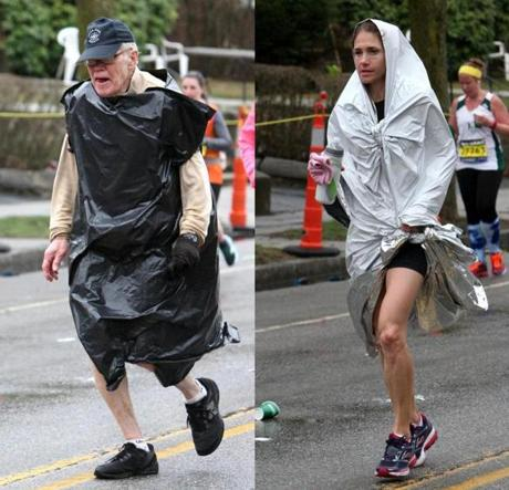 04-20-2015: Newton, MA: Runner uses an improvised coverup against the rain on Heartbreak Hill in Newton, Mass. during the Boston Marathon April 20, 2015. Photo/John Blanding, Boston Globe staff story/, Sports ( )