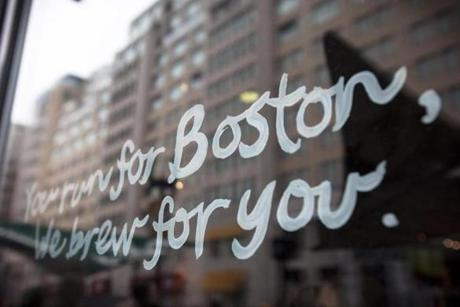 4/20/2015 - Boston, MA - Writing on the window of the Boylston Street Starbucks cheered on the runners. Boylston Street - Spectators lined the Boylston Street in Boston, near the finish of the 119th Boston Marathon on Monday, April 20, 2015. Topic: Race coverage. Photo by Dina Rudick/Globe Staff.