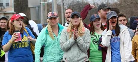 Hopkinton to Boston, MA--4/20/2015--Spectators cheer in Framingham. The 119th Boston Marathon is run on Monday, April 20, 2015. Photo by Pat Greenhouse/Globe Staff Topic: Race coverage Reporter: XXX