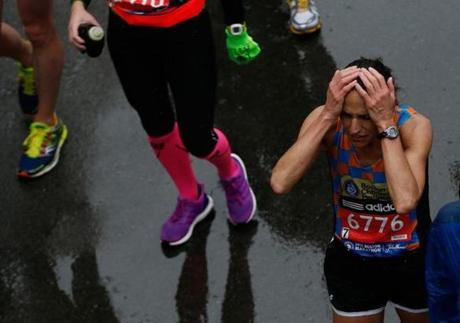 Boston, Massachusetts -- 4/20/2015-- Karolyn Bowley reacts after crossing the Boston Marathon Finish Line in Boston, Massachusetts April 20, 2015. Jessica Rinaldi/Globe Staff Topic: Reporter: