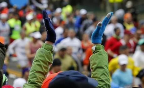 Hopkinton, MA - 4-20-15 - Boston Marathon - Wave 2 runners are applauded as they leave the start of the Boston Marathon in Hopkinton, MA. (Globe staff / Bill Greene)