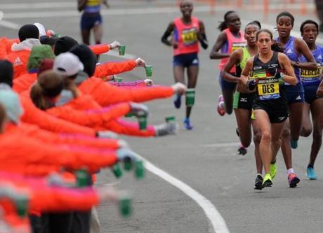 Marathon Course, MA - 04/20/15 - Hydration is offered to the elite women in Brookline during the 2015 Boston Marathon. Lane Turner/Globe Staff Section: SPORTS Reporter: various Slug: race coverage