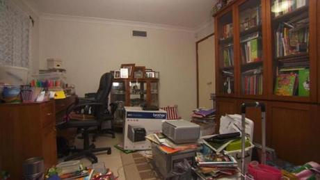 A before shot of a cluttered office.