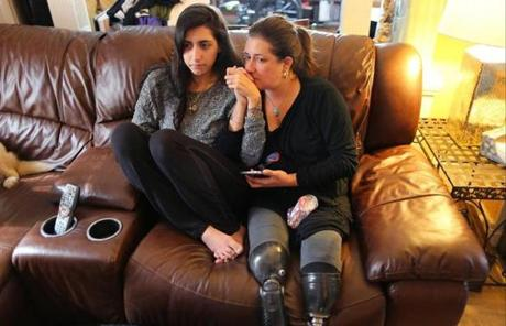 Bombing survivors Sydney Corcoran (left) and her mother Celeste held hands as they watched the verdict on television. Celeste lost both her legs in the attack.