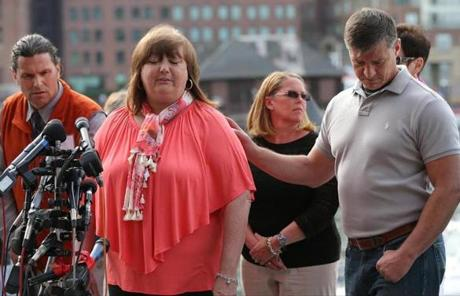Survivor Liz Norden was comforted by first responder Mike Ward as she spoke to the media.