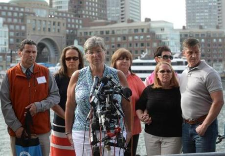 BOSTON, MA - MAY 15: Bombing victim Karen Brassard speaks to the media as Carlos Arredondo, Melida Arredondo, Liz Norden, Jean Marie Parker, and Michael Ward listen outside the John Joseph Moakley United States Courthouse May 15, 2014 in Boston, Massachusetts. Ortiz announced the death penalty sentence for the convicted Boston Marathon bomber, Dzhokhar Tsarnaev. (Photo by Darren McCollester/Getty Images)