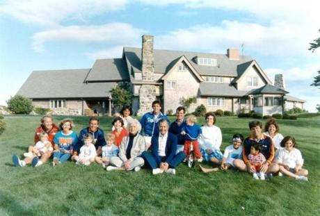 A portrait of the family taken in 1986 in front of the main house of the Bush compound. Back row: Margaret holding daughter Marshall, Marvin Bush, Bill LeBlond. Front row: Neil Bush holding son Pierce, Sharon, George W. Bush holding daughter Barbara, Laura Bush holding daughter Jenna, Barbara Bush, George Bush, Sam LeBlond, Doro Bush Lebond, George P. (Jeb's son), Jeb Bush holding son Jebby, Columba Bush, and Noelle Bush.
