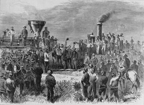 The engineers of the Union and Central Pacific locomotives shook hands upon completion of the transcontinental railroad in 1869.