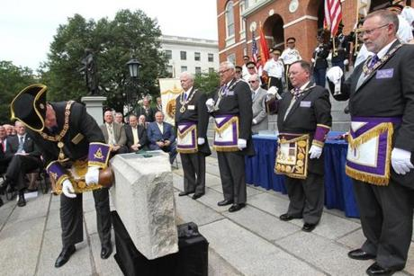 June, 17, 2015 -BOSTON, MA- harvey J. Waugh, Grand Master, Grand Lodge of Massachusetts uses a setting maul to in intricate ceremoney by the Masons as the time capsule is returned to cornerstone during ceremony at the Statehouse steps. (Boston Globe staff photo: Joanne Rathe topic: 18timecapsule reporter: josh miller section: metro)