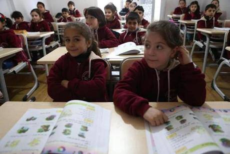 Children listened to their teacher in a Syrian private school in Mersin in March.