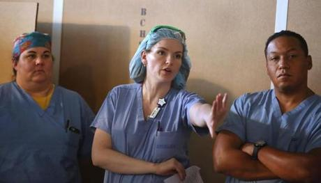 Nurse Megan Nolan talks during the debriefing after the mock surgery.