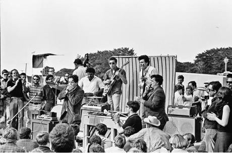The Butterfield Blues Band, with Alan Lomax on the right, in an undated photo.