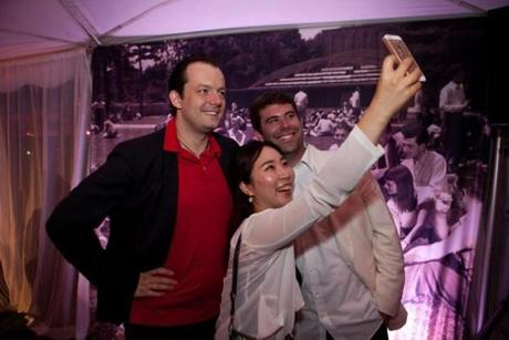 "Lenox, MA -- 08/08/15 -- Boston Symphony Orchestra Music Director Andris Nelsons poses for a selfie with musicians Ruda Lee and Evan Perry at the 75th Anniversary Tanglewood Gala party. The Tanglewood Music Center celebrated it's 75th anniversary with a gala and performance of Mahler's Symphony No 8, ""Symphony of a Thousand,"" conducted by BSO Music Director Andris Nelsons. (Kayana Szymczak for the Boston Globe)"