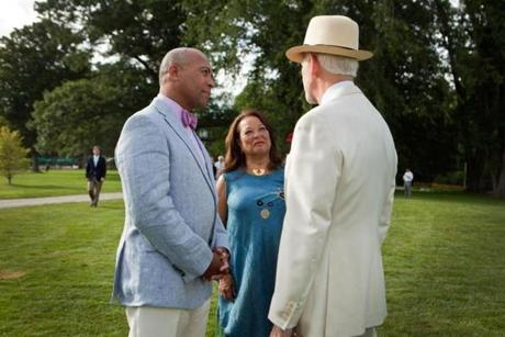 "Lenox, MA -- 08/08/15 -- Governor Deval Patrick and Dianne Patrick speak with BSO gala committee member Nathan Hayward at the Tanglewood Gala on August 8, 2015, in Lenox, Massachusetts. The Tanglewood Music Center celebrated it's 75th anniversary with a gala, and performance of Mahler's Symphony No 8, ""Symphony of a Thousand,"" conducted by BSO Music Director Andris Nelsons. (Kayana Szymczak for the Boston Globe)"