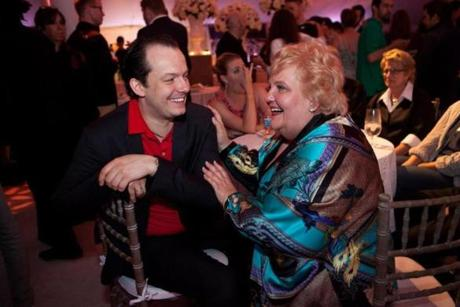 "Lenox, MA -- 08/08/15 -- Boston Symphony Orchestra Music Director Andris Nelsons speaks with mezzo-soprano soloist Jane Henschel at the 75th Anniversary Tanglewood Gala party. The Tanglewood Music Center celebrated it's 75th anniversary with a gala and performance of Mahler's Symphony No 8, ""Symphony of a Thousand,"" conducted by BSO Music Director Andris Nelsons. (Kayana Szymczak for the Boston Globe)"