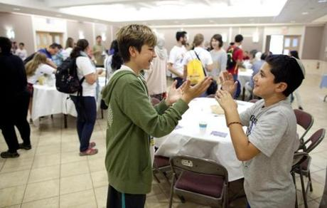 Ali Huda (left), a Boston Muslim, and Yuval Zaouy of Jerusalem, who is Jewish, played a game during a reception for the Kids4Peace camp on Sunday.
