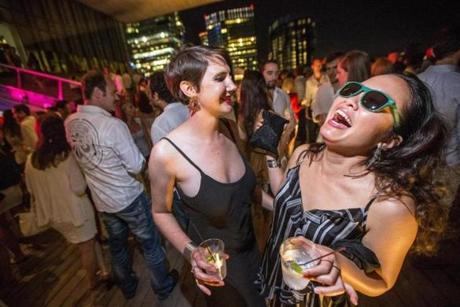 08/07/2015 BOSTON, MA Laura Martin (cq) 27 (left) and Andrea Flores (cq) 35, danced during a White Party at the ICA in Boston. (Aram Boghosian for The Boston Globe)