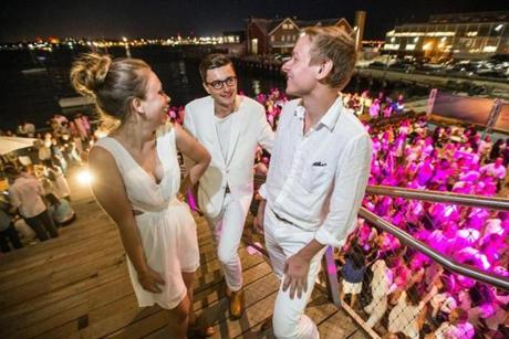 08/07/2015 BOSTON, MA L-R Emily Simon (cq), Zach Keenan (cq) and Christopher Kabacinski (cq) attend a White Party at the ICA in Boston. (Aram Boghosian for The Boston Globe)