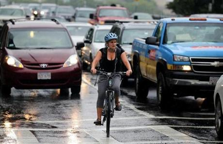 A cyclist navigates the intersection of Massachusetts Ave and Beacon St.