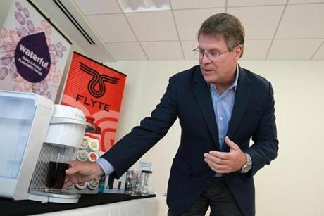 Keurig Green Mountain chief executive Brian Kelley made a cold drink during a demonstration of the new Keurig Kold machine. The beverage maker debuts on the market Tuesday.