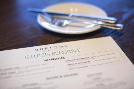 10/7/2015 - Burlington, MA - Burton's Grill - Burton's Grill locations offer gluten sensitive customers a specialized menu. Topic: 101815allergies. Story by Neil Swidey/Globe Staff. Dina Rudick/Globe Staff.