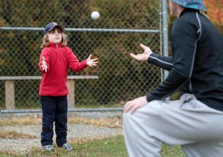 Kate Greiner, 5, prepares to catch the ball during the clinic.