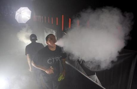 10/30/2015 Quincy, MA Ð Danny Desantis (cq) blows a vapor cloud during a cloud competition at Deja Vapes in Quincy, MA on October 30, 2015. Competitors attempt to blow the largest cloud as far as possible. (Craig F. Walker / Globe Staff)