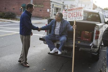 Republican Representative Geoffrey Diehl (left) greeted supporter Jack Lenoci before a campaign stop in Brockton.