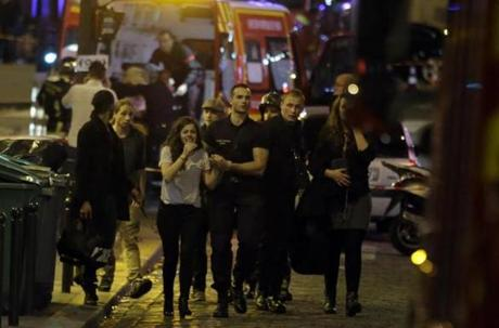 Rescuers evacuated people following an attack in Paris.