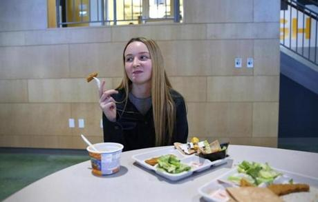 Boston, MA--11/4/2015--Junior Marissa Kennedy (cq), 16, eats her chicken tender by itself, not in the warp. Project Bread chefs Guy Koppe (cq) and Gaitskell