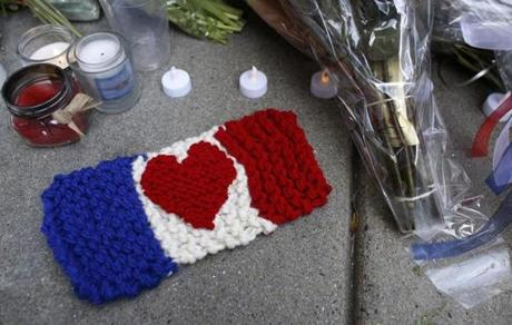 A knitted French flag rested on the sidewalk outside the French Consolate.