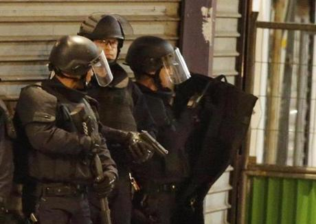 French police staged near an apartment building in Saint-Denis, a northern suburb of Paris, during a raid targeting suspected terrorists linked to Friday's deadly attacks.