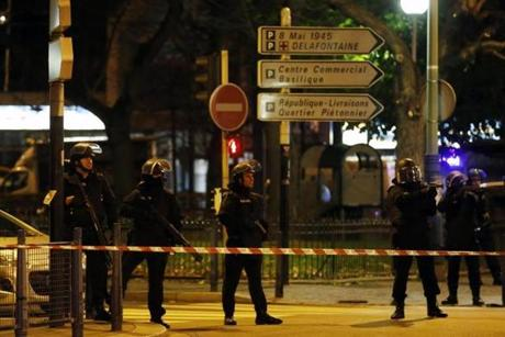 A senior police official said he believed Abdelhamid Abaaoud, a Belgian Islamic State militant and suspected mastermind of Friday's Paris attacks, was inside the apartment with five other heavily armed people.