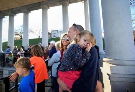 Lily Welcker rested in the arms of her father, Chris, while visiting Plymouth Rock in Plymouth.