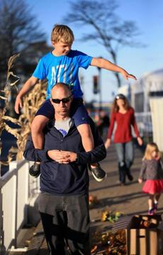 Chris Welcker gave his son Oliver a ride on his shoulders during the family's visit to Plymouth.