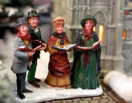 Here are some carolers in the illuminated holiday display.
