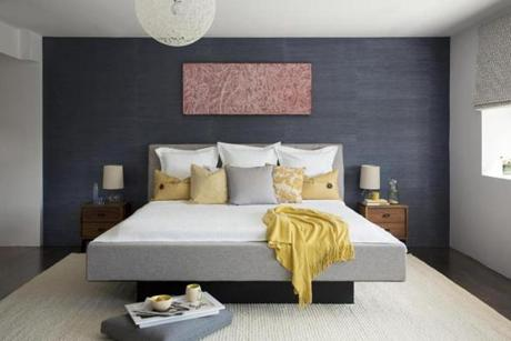 A South End bedroom with a deep-navy hemp paper