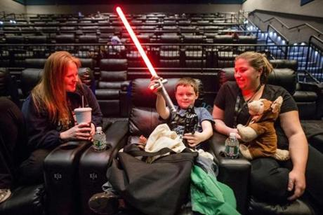 Megan Hunt (left), her son William, 7, and Kara White, were well-prepared for the 18-hour marathon, as they sat in the theater awaiting the start of the event.