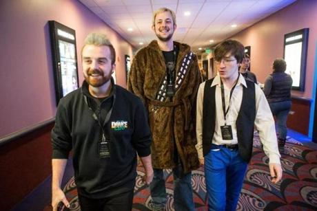 "Dylan Romani (left), Dan Socha (center), and Merrick Henry smiled as they headed for the theater the start of the 18-hour ""Star Wars"" event."