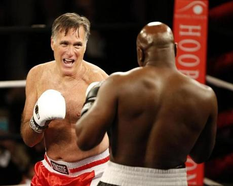 Mitt Romney and Evander Holyfield faced off in Salt Lake City May 15.