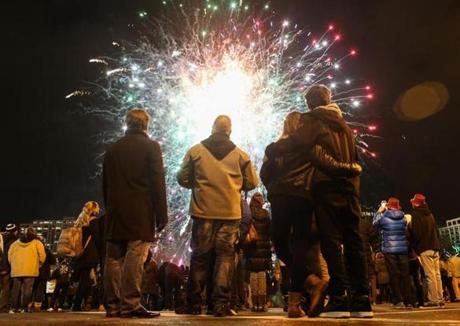 People watched early fireworks during First Night festivities.